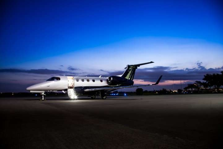 Global Concierge Services privatejet Phenom300E parked Stairs 720x480 ae64f915 bda7 48a4 804d bb4280782a99 1